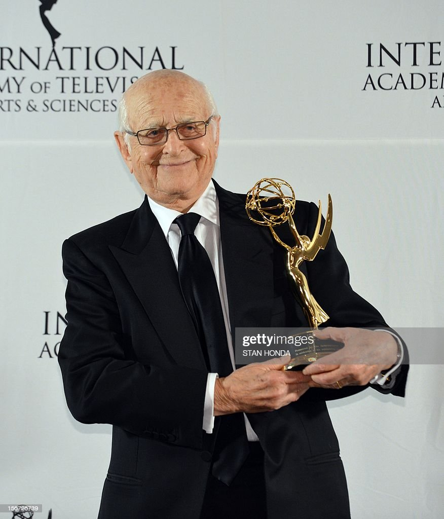 Producer Norman Lear poses with his 40th Anniversary Special Founders Award at the 40th International Emmy Awards November 19, 2012 in New York. AFP PHOTO/Stan HONDA