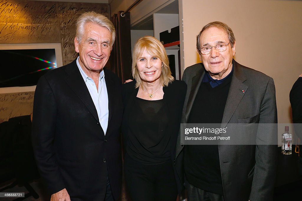 (L-R) Producer of the show Gilbert Coullier with director <a gi-track='captionPersonalityLinkClicked' href=/galleries/search?phrase=Robert+Hossein&family=editorial&specificpeople=1368725 ng-click='$event.stopPropagation()'>Robert Hossein</a> and his wife Candice Patou pose backstage following the show of impersonator Laurent Gerra 'Un spectacle Normal' at L'Olympia on December 20, 2013 in Paris, France.
