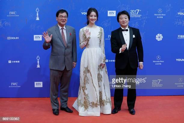 Producer Osamu Fujita actress Nozomi Sasaki and Director Toshiro Saiga arrives at the red carpet of the 7th Beijing International Film Festival on...