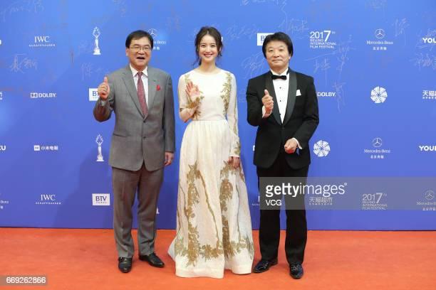 Producer Osamu Fujita actress Nozomi Sasaki and Director Toshiro Saiga arrive at the red carpet of the 7th Beijing International Film Festival at the...