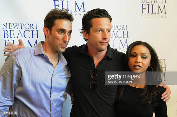 Producer Paul Alessi actor Ross McCall and actress Danielle Nicloet arrive for the premiere of the film 'Knuckle Draggers' at the Newport Beach Film...