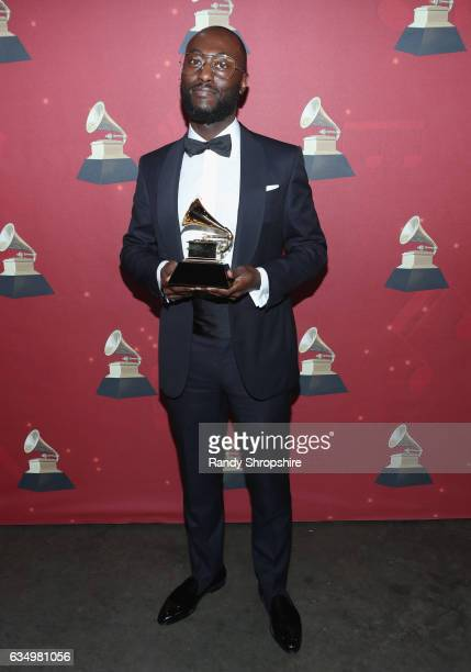 Producer Paul Jefferies poses with the Best Rap Song Grammy for 'Hotline Bling' backstage at the Premiere Ceremony during the 59th GRAMMY Awards at...