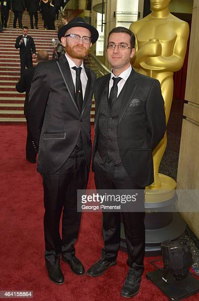 Producer Paul Young and director Tomm Moore attend the 87th Annual Academy Awards at Hollywood Highland Center on February 22 2015 in Hollywood...
