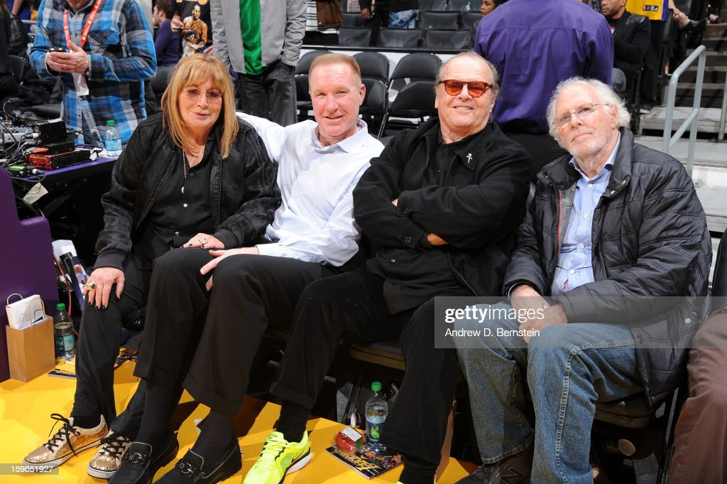 Producer Penny Marshall, former NBA player Chris Mullen, and actors Jack Nicholson and Bruce Dern pose for a photograph at Staples Center on January 15, 2013 in Los Angeles, California.