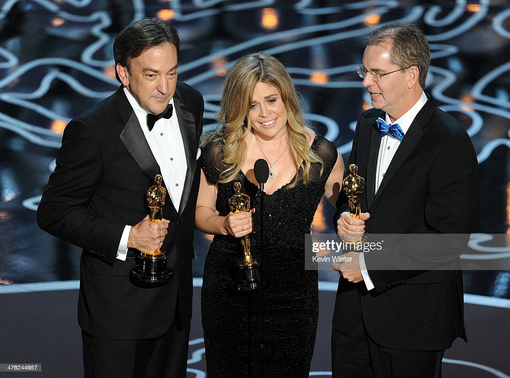 Producer Peter Del Vecho directors Jennifer Lee and Chris Buck accept the Best Animated Feature Film award for 'Frozen' onstage during the Oscars at...