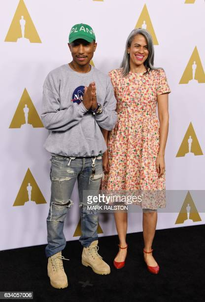 Producer Pharell Williams and Mimi Valdes arrive for the 89th Annual Academy Awards Nominee Luncheon at The Beverly Hilton Hotel in Beverly Hills...