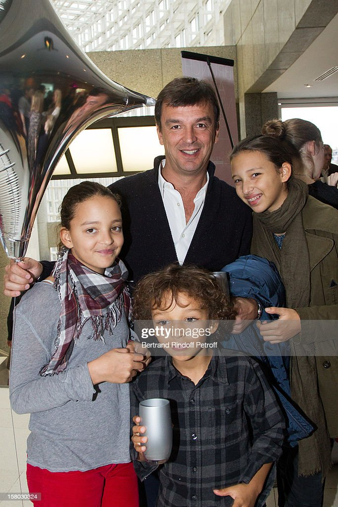 Producer Philippe Rousselet and children Ejiah, Kayla and Miles pose before the Don Quichotte Ballet Hosted By 'Reve d'Enfants' Association and AROP at Opera Bastille on December 9, 2012 in Paris, France.