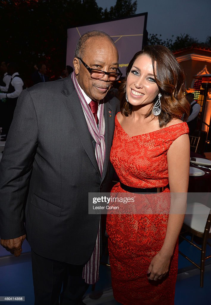 Producer <a gi-track='captionPersonalityLinkClicked' href=/galleries/search?phrase=Quincy+Jones&family=editorial&specificpeople=171797 ng-click='$event.stopPropagation()'>Quincy Jones</a> (L) and host <a gi-track='captionPersonalityLinkClicked' href=/galleries/search?phrase=Dannii+Minogue&family=editorial&specificpeople=201978 ng-click='$event.stopPropagation()'>Dannii Minogue</a> attend a gala to celebrate Etihad Airways' world-class, non-stop service between Los Angeles and Abu Dhabi at the iconic Beverly House on June 10, 2014 in Beverly Hills, California.