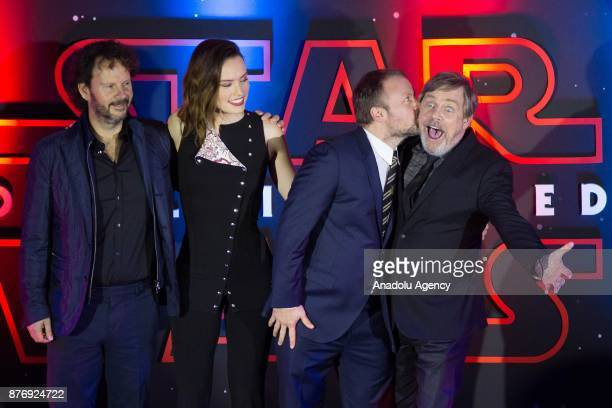 Producer Ram Bergman actress Daisy Ridley director Rian Johnson and actor Mark Hamill attend the 'Star Wars The Last Jedi' premiere at Oasis shopping...