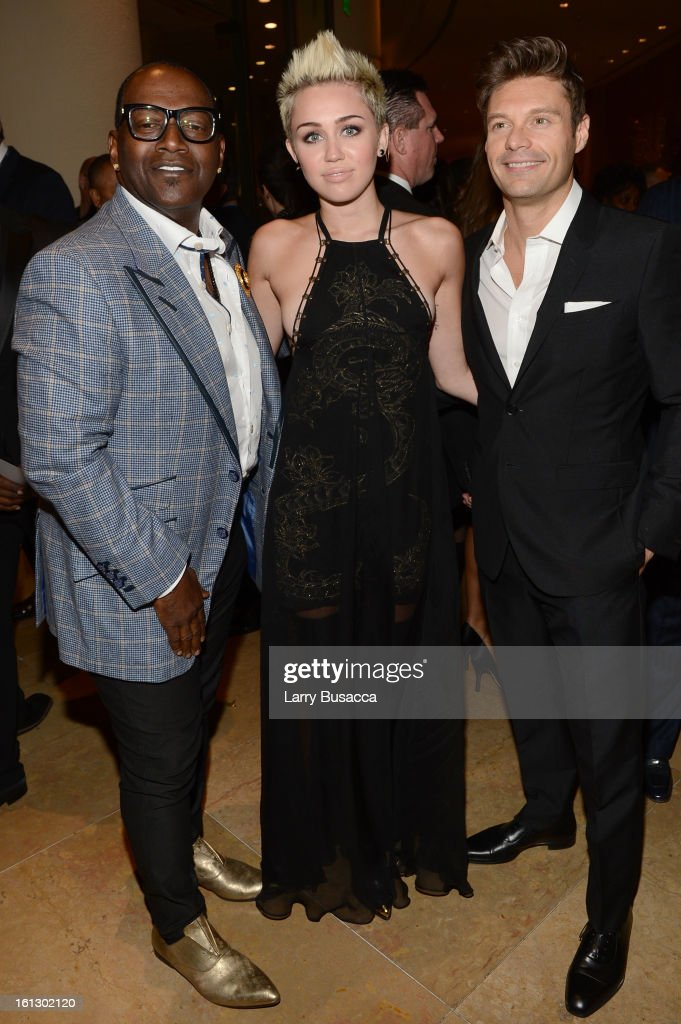 Producer Randy Jackson, singer Miley Cyrus and TV personality Ryan Seacrest arrive at the 55th Annual GRAMMY Awards Pre-GRAMMY Gala and Salute to Industry Icons honoring L.A. Reid held at The Beverly Hilton on February 9, 2013 in Los Angeles, California.