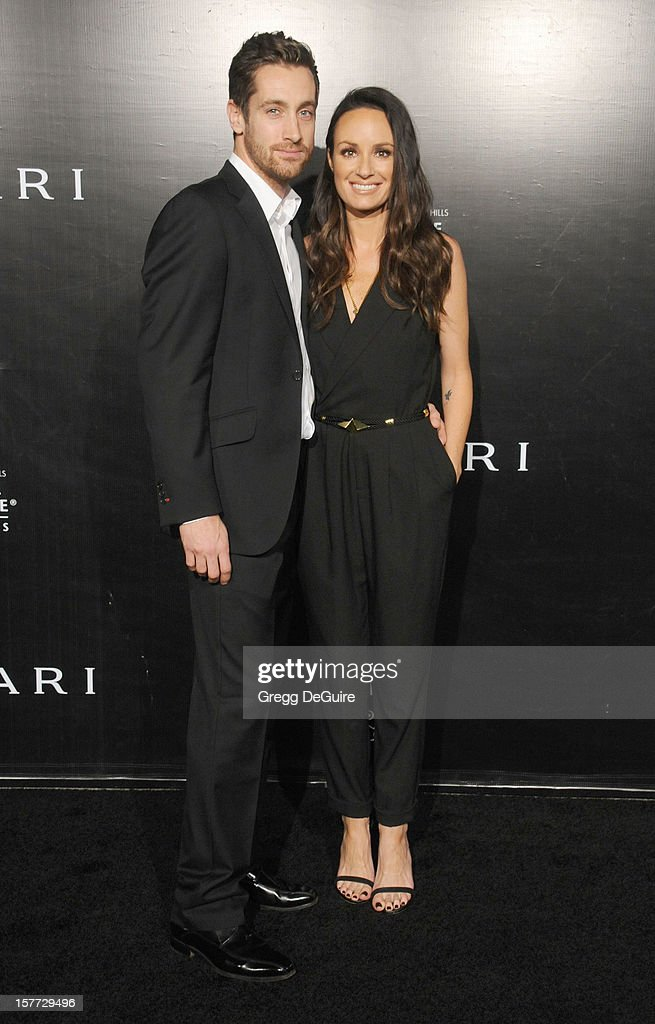 Producer Rhys David Thomas and TV personality Catt Sadler arrive at the Rodeo Drive Walk of Style honoring Bvlgari on December 5, 2012 in Beverly Hills, California.