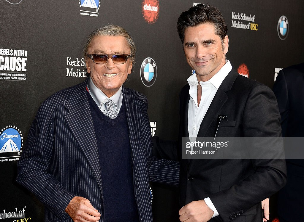 Producer <a gi-track='captionPersonalityLinkClicked' href=/galleries/search?phrase=Robert+Evans+-+Producer&family=editorial&specificpeople=12429532 ng-click='$event.stopPropagation()'>Robert Evans</a> and actor <a gi-track='captionPersonalityLinkClicked' href=/galleries/search?phrase=John+Stamos&family=editorial&specificpeople=206285 ng-click='$event.stopPropagation()'>John Stamos</a> arrive at the 2nd Annual Rebels With A Cause Gala at Paramount Studios on March 20, 2014 in Hollywood, California.
