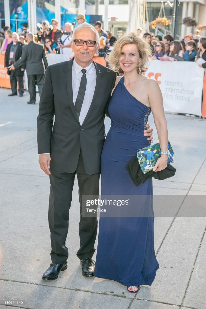 Producer Roger Frappier and Caroline Dumas attend 'The Grand Seduction' premiere during the 2013 Toronto International Film Festival at Roy Thomson Hall on September 8, 2013 in Toronto, Canada.