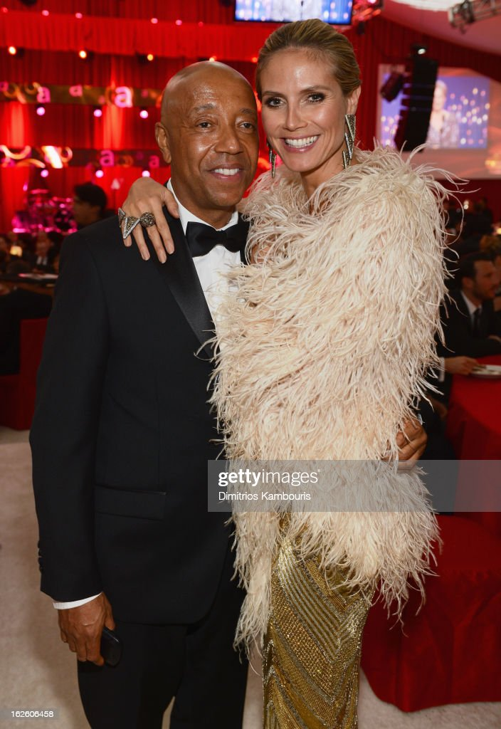 Producer Russell Simmons and model Heidi Klum attend the 21st Annual Elton John AIDS Foundation Academy Awards Viewing Party at West Hollywood Park on February 24, 2013 in West Hollywood, California.