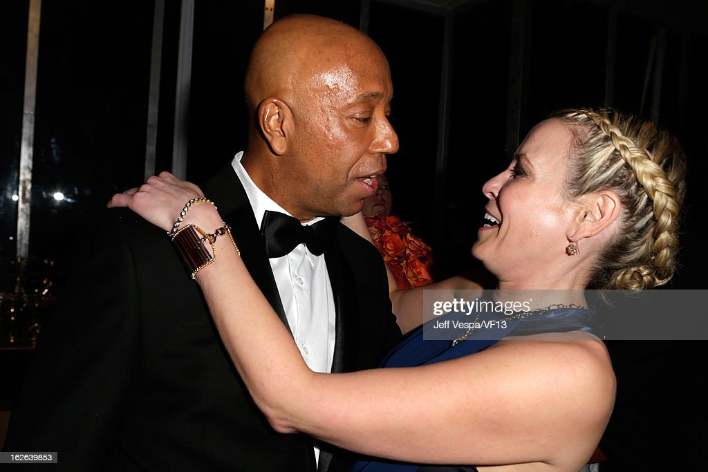 Producer Russell Simmons (L) and tv host Chelsea Handler attend the 2013 Vanity Fair Oscar Party hosted by Graydon Carter at Sunset Tower on February 24, 2013 in West Hollywood, California.