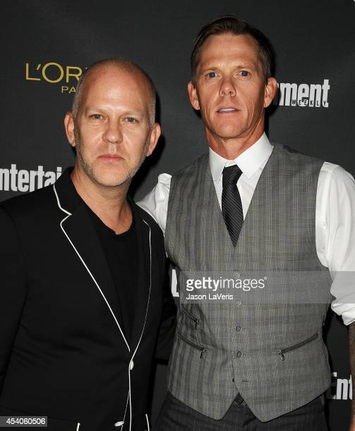 Producer Ryan Murphy and husband David Miller attend the 2014 Entertainment Weekly preEmmy party at Fig Olive Melrose Place on August 23 2014 in West...