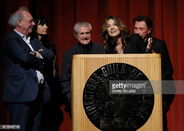 Producer Samuel Hadida writer Valerie Perrin director Claude Lelouch actress Nadia Fares and singer Johnny Hallyday attend the Colcoa French Film...