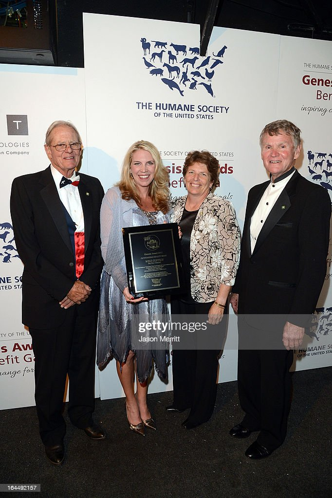 Producer Sarah Whalen (2nd from L) poses backstage with the Outstanding Reality Series award and members of the Board of Directors of the California Wildlife Officers Foundation Judd Hanna, Peter Stent and former Chief Law Enforcement Nancy Foley at The Humane Society of the United States 2013 Genesis Awards Benefit Gala at The Beverly Hilton Hotel on March 23, 2013 in Los Angeles, California.