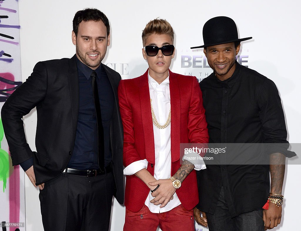 Producer Scooter Braun, singer/producer Justin Bieber and producer Usher arrive at the premiere of Open Road Films' 'Justin Bieber's Believe' at Regal Cinemas L.A. Live on December 18, 2013 in Los Angeles, California.