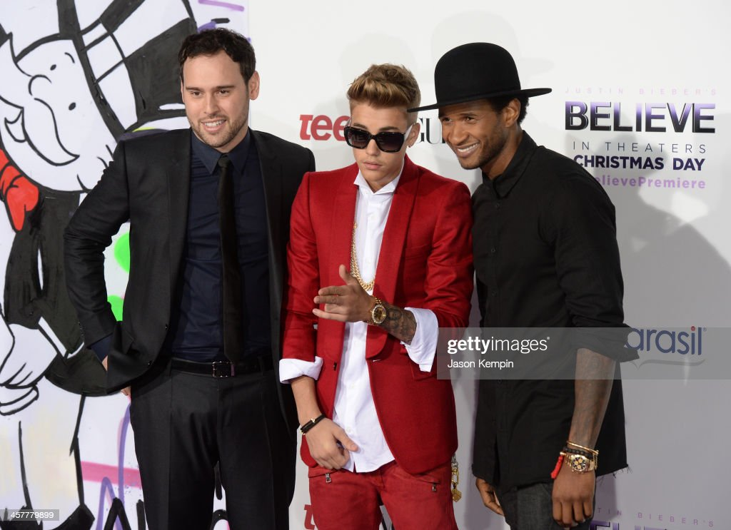 Producer Scooter Braun singer/producer Justin Bieber and producer Usher attend the premiere of Open Road Films' 'Justin Bieber's Believe' at Regal...