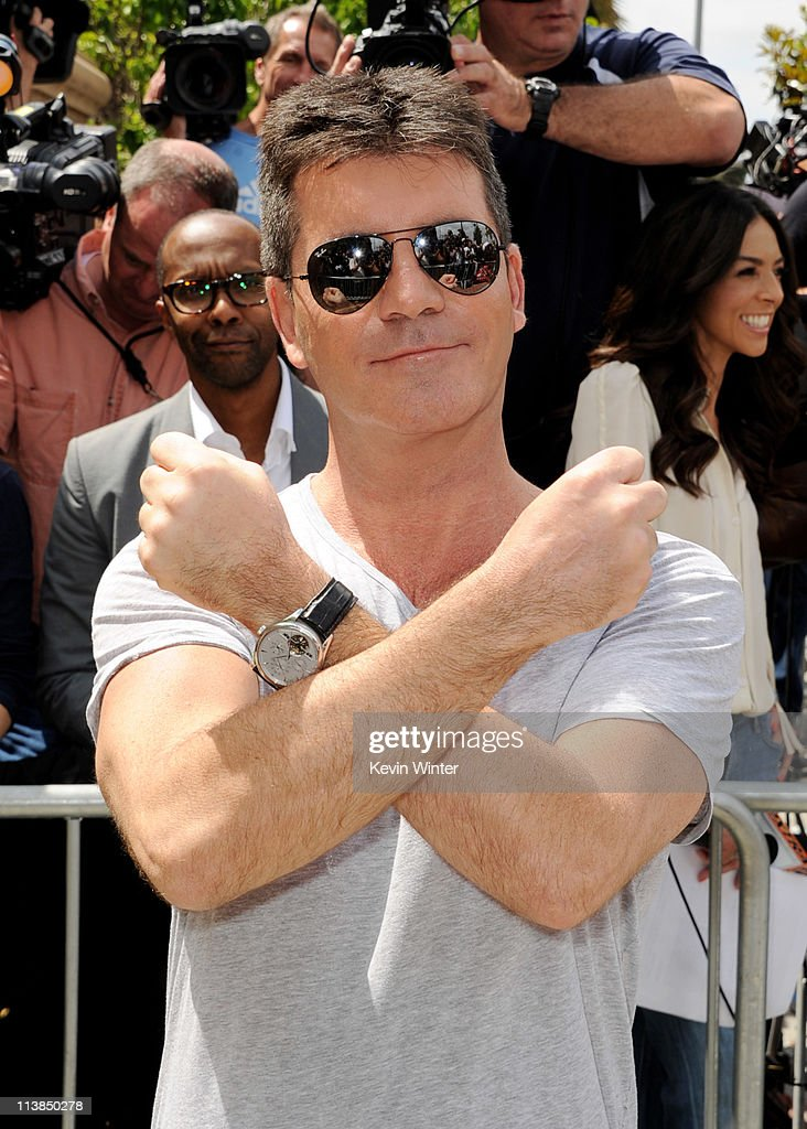 Producer <a gi-track='captionPersonalityLinkClicked' href=/galleries/search?phrase=Simon+Cowell&family=editorial&specificpeople=203007 ng-click='$event.stopPropagation()'>Simon Cowell</a> arrives at the first round of auditions for Fox's 'The X Factor' at Galen Center on May 8, 2011 in Los Angeles, California.