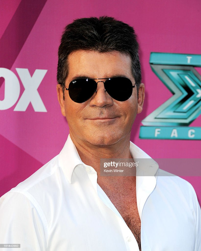 Producer <a gi-track='captionPersonalityLinkClicked' href=/galleries/search?phrase=Simon+Cowell&family=editorial&specificpeople=203007 ng-click='$event.stopPropagation()'>Simon Cowell</a> arrives at the premiere of Fox's 'The X Factor' Season 2 and handprint ceremony at the Chinese Theatre on September 11, 2012 in Los Angeles, California.