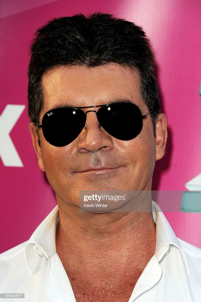 Producer Simon Cowell arrives at the premiere of Fox's 'The X Factor' Season 2 and handprint ceremony at the Chinese Theatre on September 11, 2012 in Los Angeles, California.
