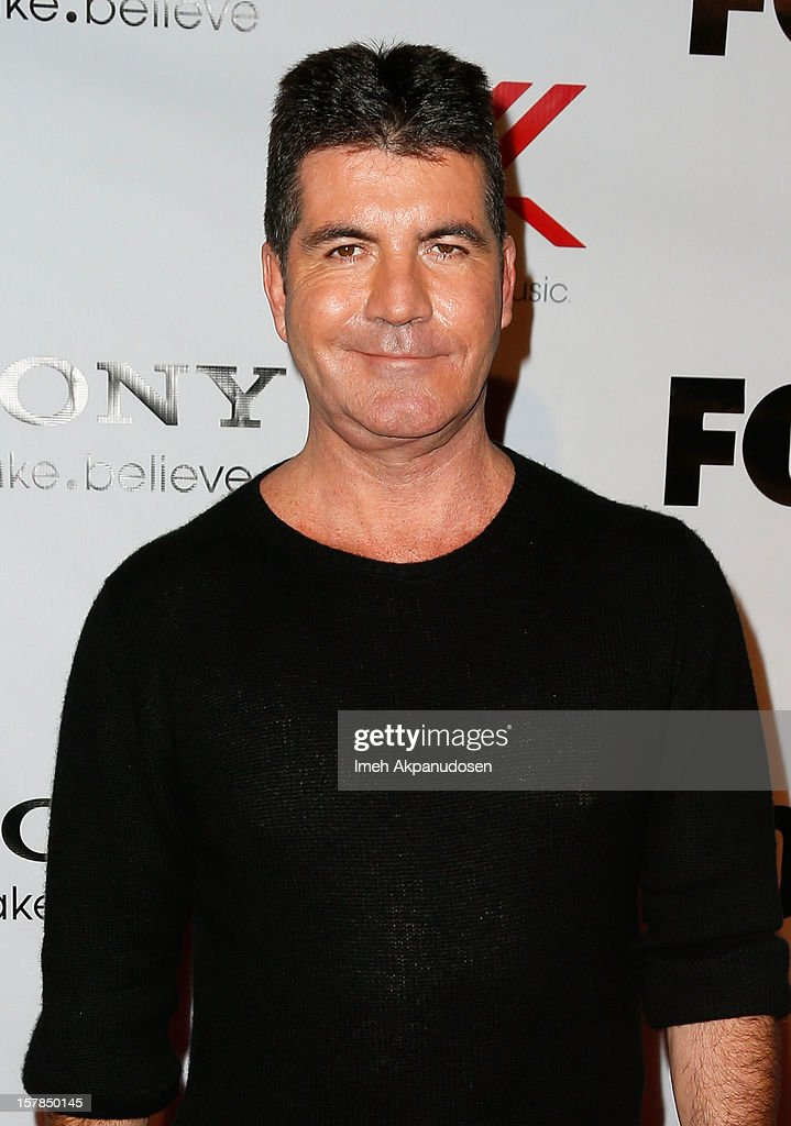 Producer Simon Cowell attends Fox's 'The X Factor' viewing party at Mixology101 & Planet Dailies on December 6, 2012 in Los Angeles, California.