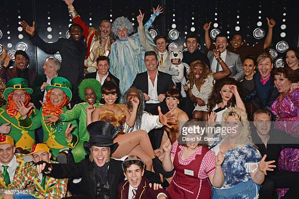 Producer Simon Cowell poses with the cast backstage following the press night performance of 'I Can't Sing The X Factor Musical' at the London...