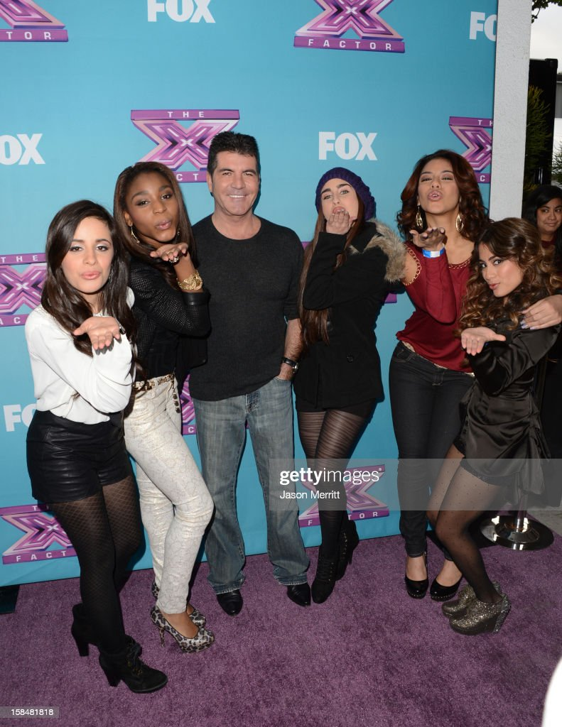 Producer Simon Cowell (C) with X Factor contestants Fifth Harmony attend Fox's 'The X Factor' season finale news conference at CBS Television City on December 17, 2012 in Los Angeles, California.