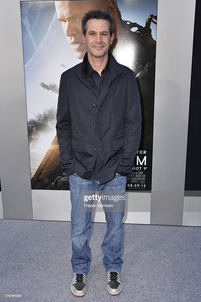 Producer <a gi-track='captionPersonalityLinkClicked' href=/galleries/search?phrase=Simon+Kinberg&family=editorial&specificpeople=2347671 ng-click='$event.stopPropagation()'>Simon Kinberg</a> arrives at the premiere of TriStar Pictures' 'Elysium' at Regency Village Theatre on August 7, 2013 in Westwood, California.