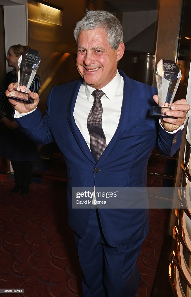 Producer Sir Cameron Mackintosh poses with the Best Musical Revival and Best West End Musical awards won by 'Miss Saigon' in the press room at the WhatsOnStage Awards at The Prince of Wales Theatre on February 15, 2015 in London, England.