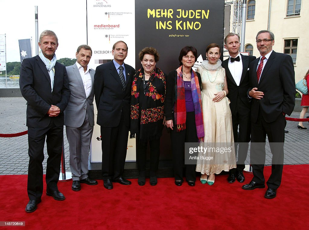 Producer Soentge Wortmann, Richy Mueller, Yakov Hadas-Handelsmann, Israeli ambassador in Berlin, Nicola Galliner, president of the festival, Mrs. Hadas, singer <a gi-track='captionPersonalityLinkClicked' href=/galleries/search?phrase=Meret+Becker&family=editorial&specificpeople=726204 ng-click='$event.stopPropagation()'>Meret Becker</a>, singer <a gi-track='captionPersonalityLinkClicked' href=/galleries/search?phrase=Max+Raabe&family=editorial&specificpeople=5103306 ng-click='$event.stopPropagation()'>Max Raabe</a> and <a gi-track='captionPersonalityLinkClicked' href=/galleries/search?phrase=Matthias+Platzeck&family=editorial&specificpeople=605525 ng-click='$event.stopPropagation()'>Matthias Platzeck</a>, prime minister of Brandenburg, attend the Opening Gala of the 18th Jewish Film Festival Berlin & Potsdam at Hans Otto Theater on June 4, 2012 in Potsdam, Germany.