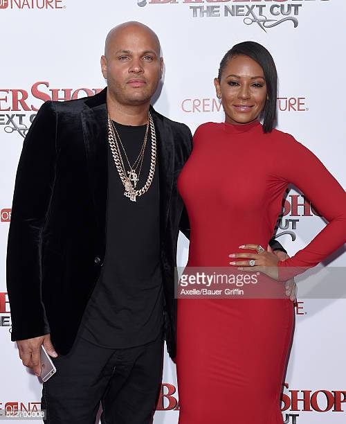 Producer Stephen Belafonte and actress/singer Melanie Brown arrive at the premiere of New Line Cinema's 'Barbershop The Next Cut' at TCL Chinese...