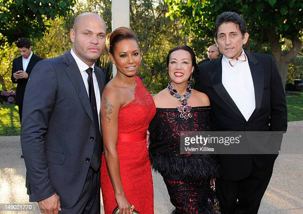 Producer Stephen Belafonte recording artist Melanie 'Mel B' Brown fashion designer Sue Wong and a guest attend HollyRod Foundation's 14th Annual...