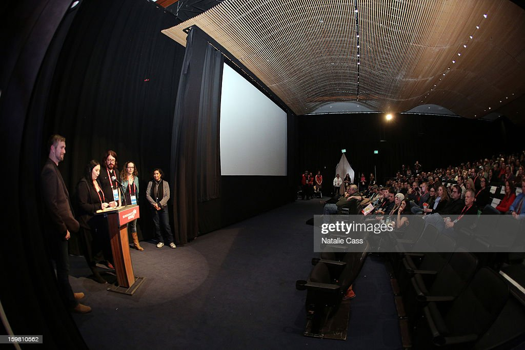 Producer Stephen Dotson. directors Audrey Ewell, Aaron Aites and Nina Krstic and Senior Programmer Sundance Film Festival & New Frontier at Sundance Shari Frilot speak onstage during the '99% - The Occupy Wall Street Collaborative Film' premiere at Egyptian Theatre during the 2013 Sundance Film Festival on January 20, 2013 in Park City, Utah.
