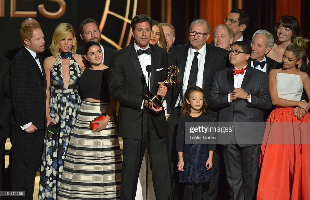Producer Steve Levitan (C) and cast and crew of 'Modern Family' appear onstage at the 66th Annual Primetime Emmy Awards held at Nokia Theatre L.A. Live on August 25, 2014 in Los Angeles, California.