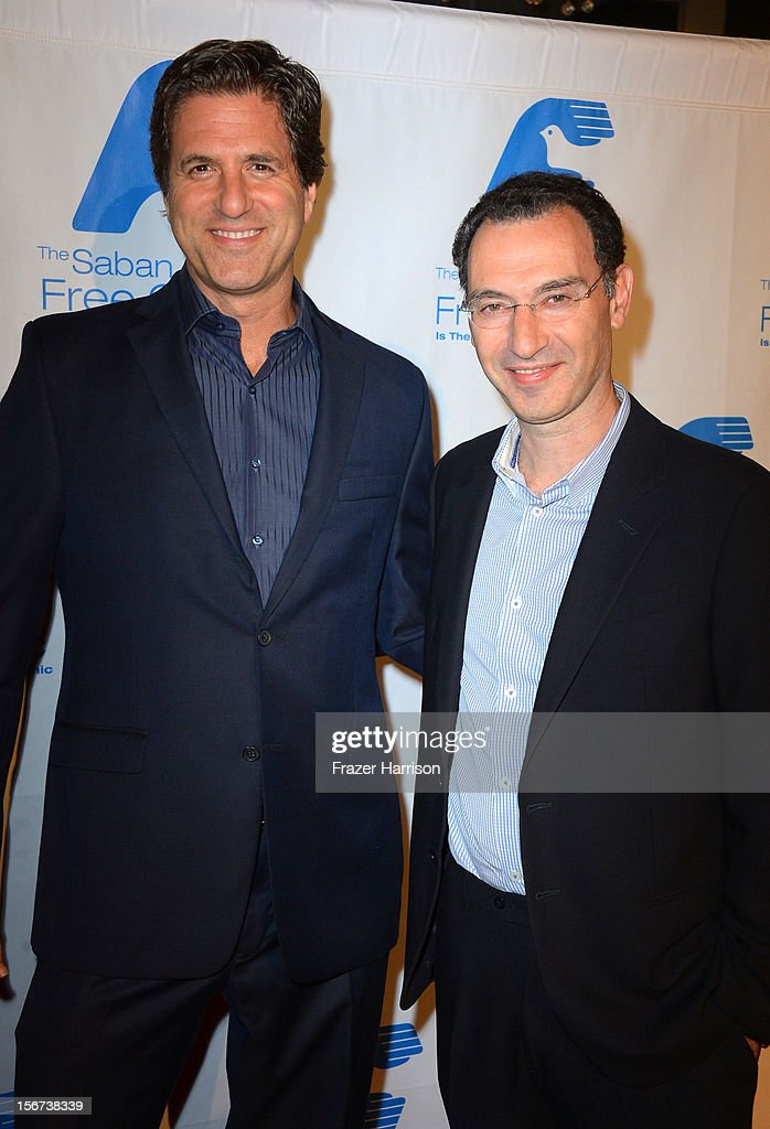 Producer Steve Levitan and honoree Paul Lee arrive at The Saban Free Clinic's Gala Honoring ABC Entertainment Group President Paul Lee and Bob Broder at The Beverly Hilton Hotel on November 19, 2012 in Beverly Hills, California.