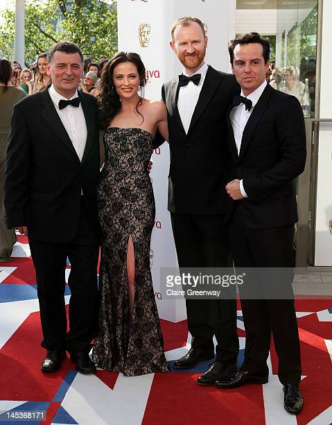 Producer Steven Moffat and actors Lara Pulver Mark Gatiss and Andrew Scott attend The Arqiva British Academy Television Awards 2012 at The Royal...