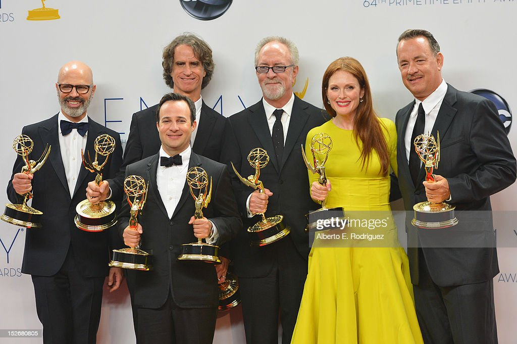 Producer Steven Shareshian, director <a gi-track='captionPersonalityLinkClicked' href=/galleries/search?phrase=Jay+Roach&family=editorial&specificpeople=2576157 ng-click='$event.stopPropagation()'>Jay Roach</a>, writer Danny Strong, producer <a gi-track='captionPersonalityLinkClicked' href=/galleries/search?phrase=Gary+Goetzman&family=editorial&specificpeople=830083 ng-click='$event.stopPropagation()'>Gary Goetzman</a>, actress <a gi-track='captionPersonalityLinkClicked' href=/galleries/search?phrase=Julianne+Moore&family=editorial&specificpeople=171555 ng-click='$event.stopPropagation()'>Julianne Moore</a>, and producer <a gi-track='captionPersonalityLinkClicked' href=/galleries/search?phrase=Tom+Hanks&family=editorial&specificpeople=201790 ng-click='$event.stopPropagation()'>Tom Hanks</a> pose in the 64th Annual Emmy Awards press room at Nokia Theatre L.A. Live on September 23, 2012 in Los Angeles, California.