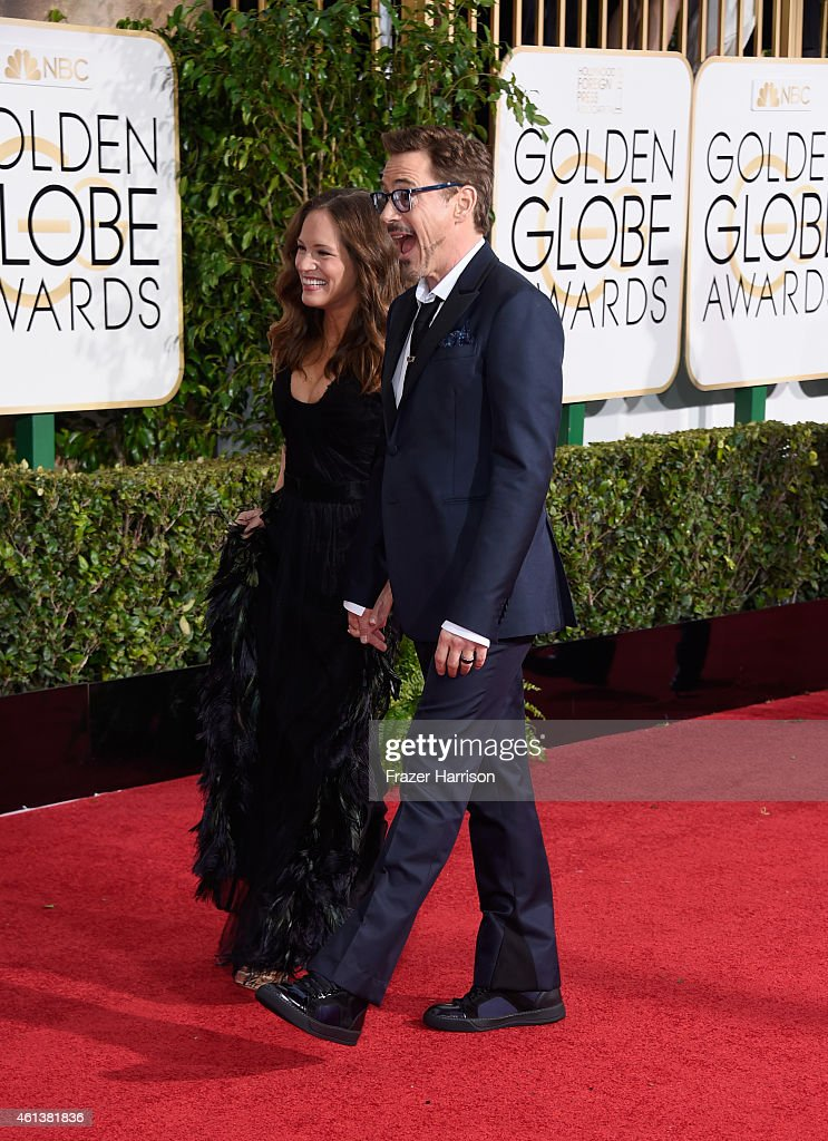 Producer Susan Downey (L) and actor Robert Downey, Jr. attend the 72nd Annual Golden Globe Awards at The Beverly Hilton Hotel on January 11, 2015 in Beverly Hills, California.