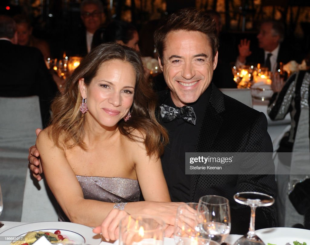 Producer Susan Downey and actor Robert Downey Jr., wearing Gucci, attend the LACMA 2013 Art + Film Gala honoring Martin Scorsese and David Hockney presented by Gucci at LACMA on November 2, 2013 in Los Angeles, California.