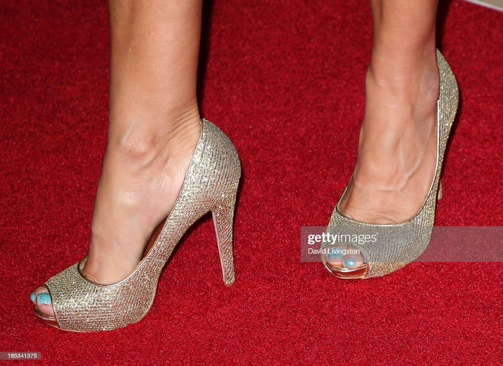 Producer Suzanne DeLaurentiis (shoe detail) attends the launch of the Redlight Traffic app at the Dignity Gala at The Beverly Hilton Hotel on October 18, 2013 in Beverly Hills, California.
