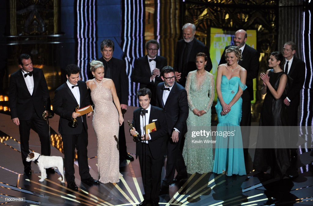 Producer Thomas Langmann accepts the Best Picture Award for 'The Artist' as he is onstage with members of the cast and crew during the 84th Annual...