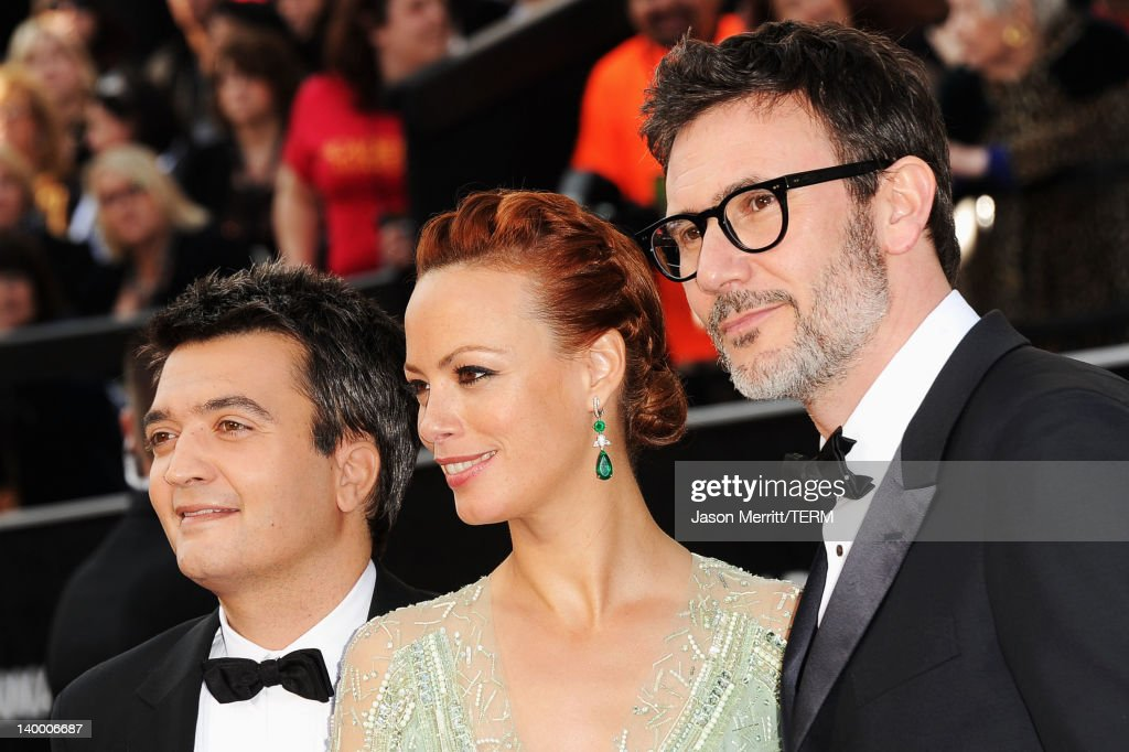 Producer Thomas Langmann actress Berenice Bejo and writerdirector Michel Hazanavicius arrive at the 84th Annual Academy Awards held at the Hollywood...