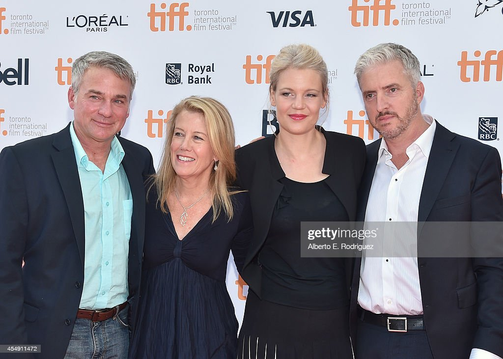 Producer Tim Bevan producer Lisa Bruce Eva Maywald and screenwriter/producer Anthony McCarten attend 'The Theory Of Everything' premiere during the...