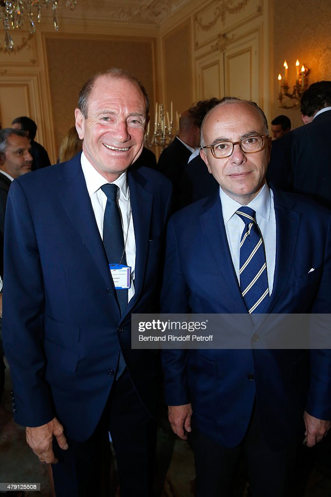 Producer Tim Newman and French 'Ministre de l'Interieur' <a gi-track='captionPersonalityLinkClicked' href=/galleries/search?phrase=Bernard+Cazeneuve&family=editorial&specificpeople=4205153 ng-click='$event.stopPropagation()'>Bernard Cazeneuve</a> attend the 'Une Nuit avec la Police et la Gendarmerie' : France 2 TV Show. Held at Ministere de l'Interieur in Paris on June 30, 2015 in Paris, France.