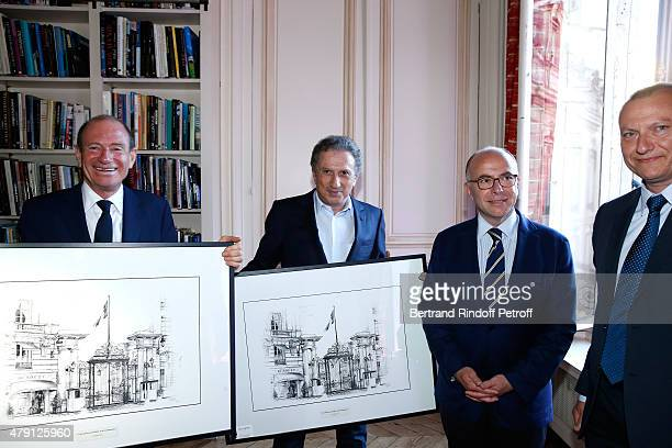 Producer Tim Newman Presenter of the show Michel Drucker French 'Ministre de l'Interieur' Bernard Cazeneuve and Artist Yann Eyhorn who offered his...