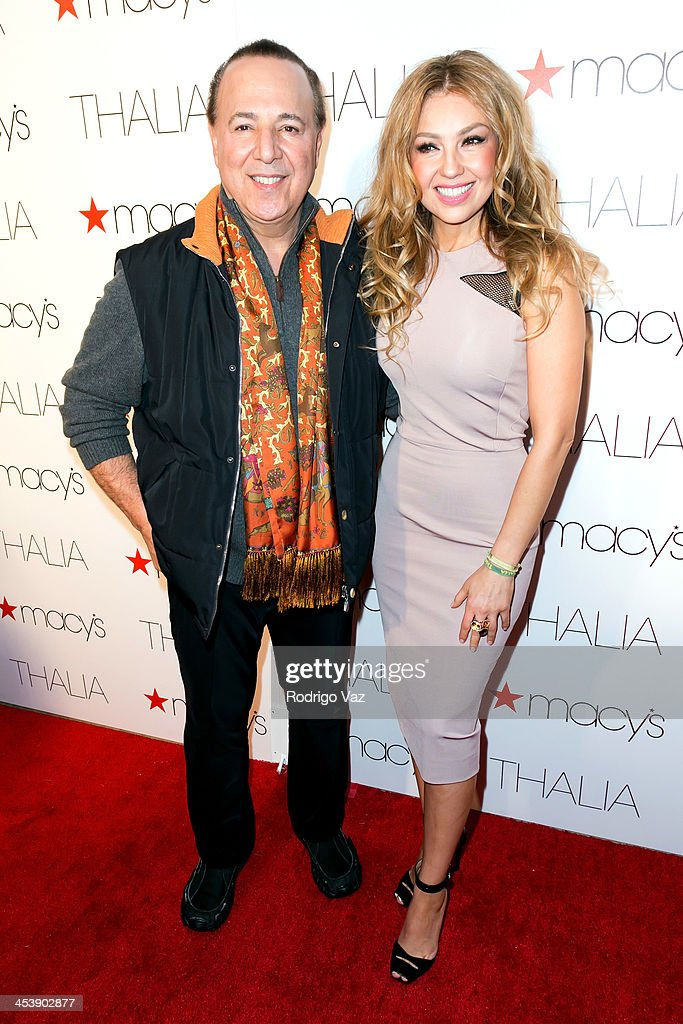 Producer <a gi-track='captionPersonalityLinkClicked' href=/galleries/search?phrase=Tommy+Mottola&family=editorial&specificpeople=239164 ng-click='$event.stopPropagation()'>Tommy Mottola</a> (L) and singer Thalia arrive as Macy's honors Latin superstar Thalia at Sunset Tower on December 5, 2013 in West Hollywood, California.