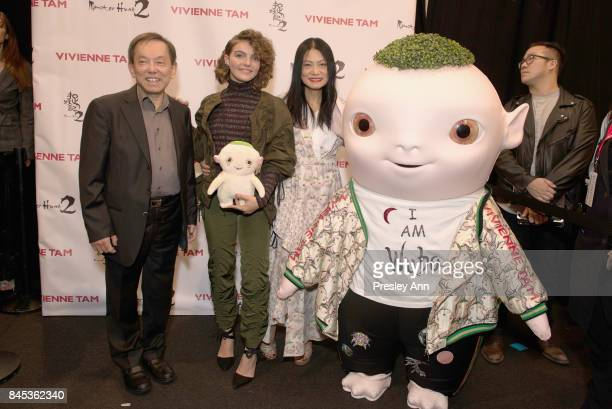 Producer William Kong Camren Bicondova designer Vivienne Tam and Wuba pose backstage for Vivienne Tam fashion show during New York Fashion Week The...